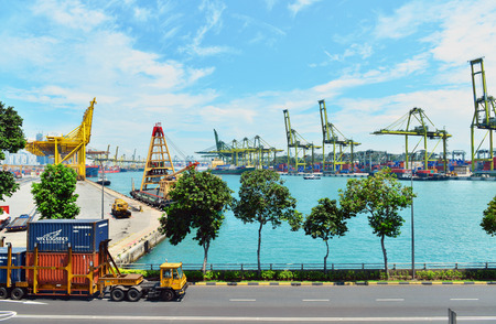 hundreds and thousands: SINGAPORE - Nov 18, 2015: Commercial port of Singapore. Bird eye panoramic view of busiest Asian cargo port with hundreds of ships loading export and import goods and thousands of containers in harbor