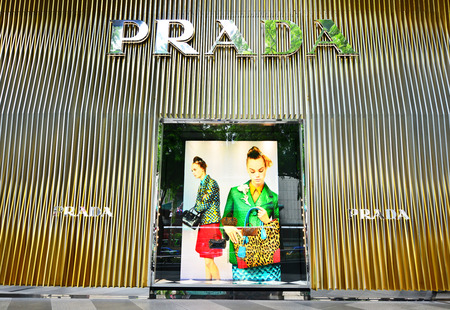 ions: SINGAPORE - NOV 18: Prada store at ION Orchard shopping mall in Singapore on November 18, 2015 in Singapore. Ions Media Facade is a multi-sensory canvas media wall made with cutting-edge technology. Editorial