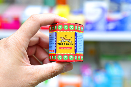 BANGKOK, THAILAND -JUNE 2016 : Handle Packages of Tiger Balm in drugstore Bangkok, Thailand on June 4, 2016. Tiger Balm is medicinal ointment made from herbs that has pain-relieving remedy