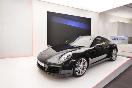 paragon: BANGKOK - JUNE 9 : Porsche sport car. show room at Siam Paragon on June 9, 2016, This is one of the biggest shopping center in Asia. It includes a wide range of specialty stores and restaurants.