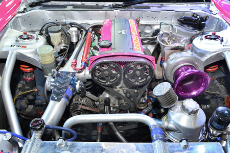 supercharged: BANGKOK - JUNE 23 : Highly modified engine restored for competition showing at Bangkok International Auto Salon 2016 on June 23, 2016 in Bangkok, Thailand. Event of decoration and modify car.