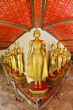 jade buddha temple: Row of Sacred Golden Buddha images in Bangkok, Thailand Editorial