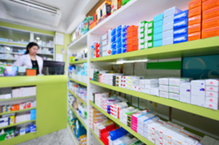 Many medicines on shelf in blur pharmacy drugstore Imagens