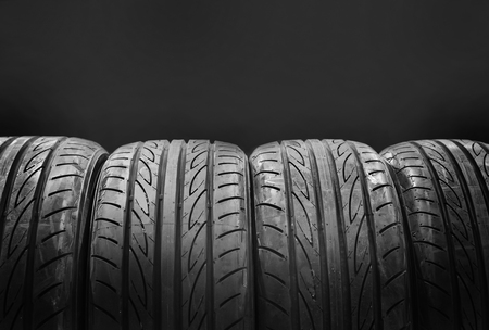 winter tires: Car tires isolated on black background Stock Photo