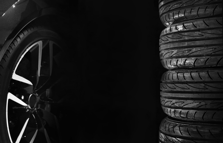 Set of car tires with alloy wheels isolated on black background
