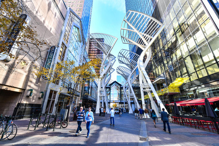 CALGARY, CANADA: Pedestrians walking past retail outlets along Stephen Ave in Autumn, Calgary, Alberta. Stephen Ave is a famous pedestrian mall in downtown Calgary Редакционное