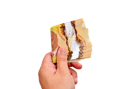 Hand holding canadian banknote