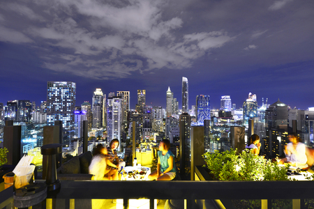 BANGKOK - THAILAND February 12, 2018: Twilight time from 26 Rooftop Bar at Hotel Indigo Bangkok Wireless Road Bangkok, overlooking a magnificent cityscape Editorial