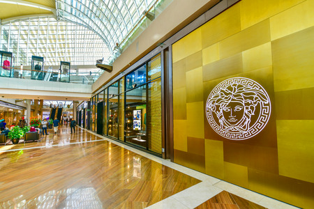 SINGAPORE - OCTOBER 3, 2018: Versace store in Marina Bay Sands Shopping mall. Versace, is an Italian fashion company and trade name founded by Gianni Versace in 1978