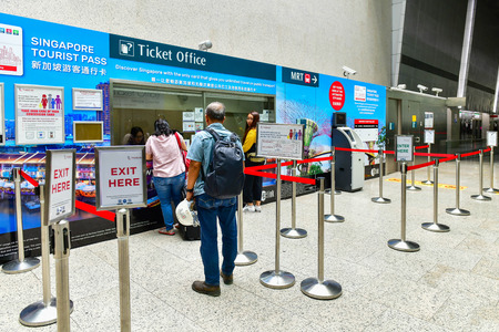 SINGAPORE -OCTOBER 1,2018: Tourist buying a ticket General Ticketing Machine (GTM) of Singapore Mass Rapid Transit (MRT) In T2 Changi International Airport