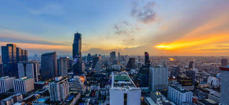 View of Bangkok modern office buildings, condominium in Bangkok city downtown with sunset sky
