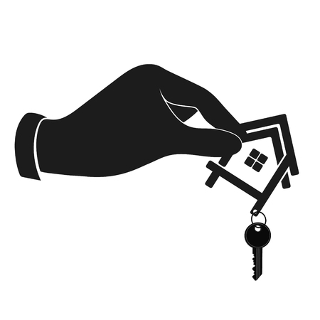 house construction: The house with the key in his hand is silhouetted. Construction and rental housing.