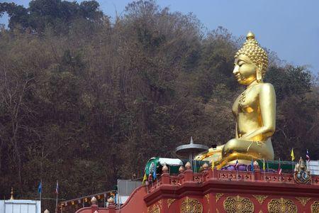 sop: Golden Buddha on the Mekong river, Ban Sop Ruak Stock Photo