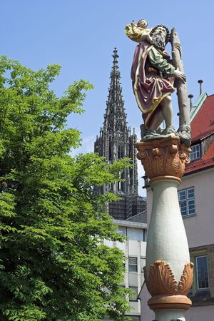 Ulm Minster spire with St Christopher Statue (1584) foreground, Germany photo
