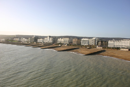 breakwaters: View of beach with buildings Stock Photo