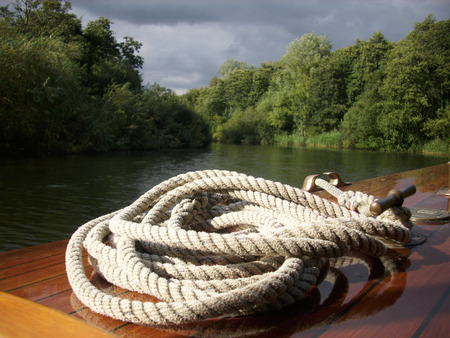 coiled rope: Boat with coiled rope on bow