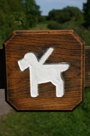 Rustic dogs on leads sign