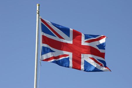 flagpole: Union Jack flag flying on a flagpole Stock Photo