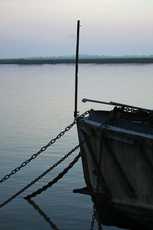 burnham: Anchor chains hanging from boat