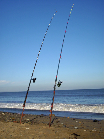 sea fishing: Sea fishing rods on beach