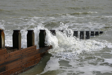 seafronts: Waves crashing against a breakwater at Eastbourne Stock Photo