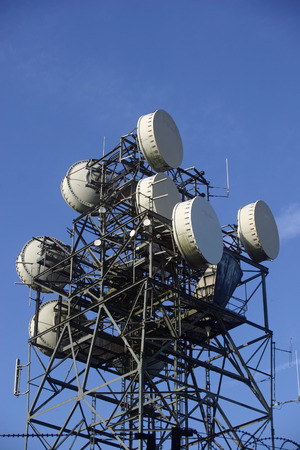 Metal telecommunications mast with aerials and dishes
