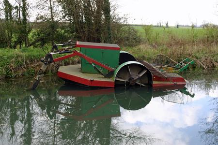 dredging: Basingstoke canal weedcutting and dredging paddle boat
