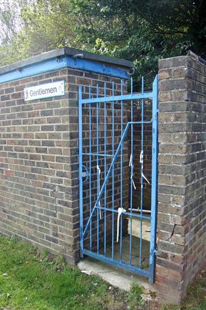 conveniences: Brick built closed gentlemens park toilet Stock Photo