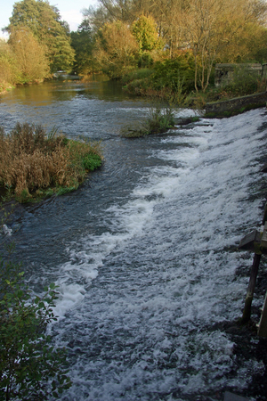 weir: Weir with white water linking a canal to a river
