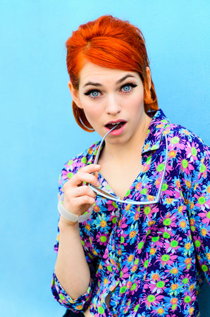 60: The beautiful girl with red hair and points, in style of 60 years, Fashion. Model. Stock Photo