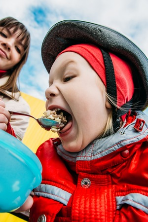 decided: after an active skating, the family decided to have a meal Stock Photo
