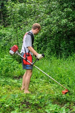 mows: gardener mows the weeds in my garden