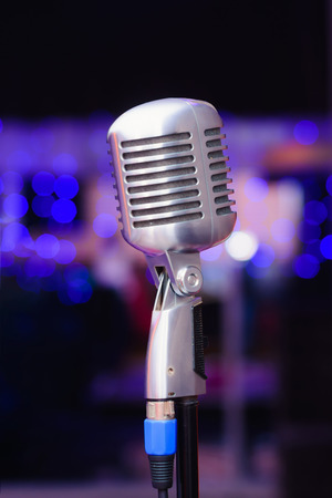 mc: silver microphone on stand close-up at the club