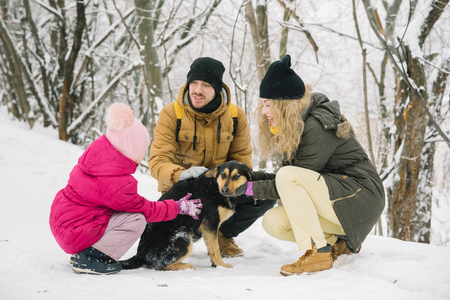 family spends time together in the winter Stock Photo