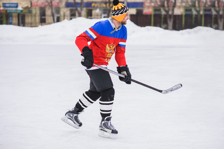 icehockey: with a stick man riding on ice