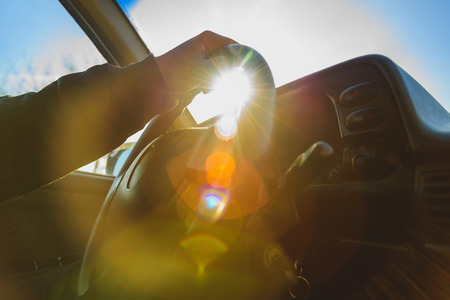 afternoon sun glare filled the car interior