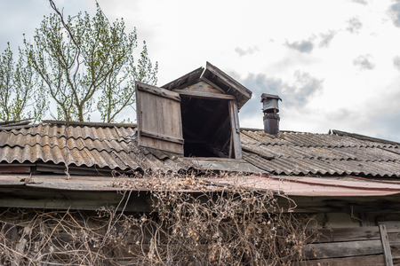 attic: Old abandoned rotting house in the yard