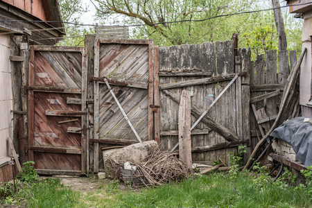 Old decaying wooden gates in the yard Stock Photo