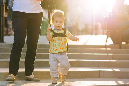 strapped: Mothers teach to walk on the road