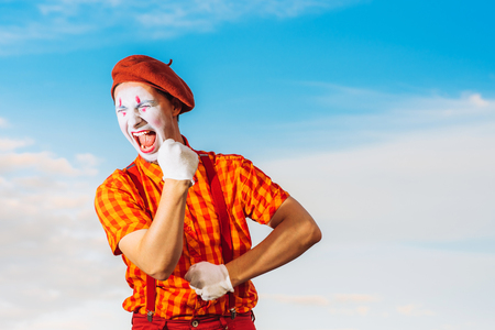 Actor shows pantomime against the blue sky