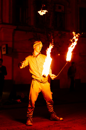 igniting: The guy on the street turns a torch of fire Stock Photo