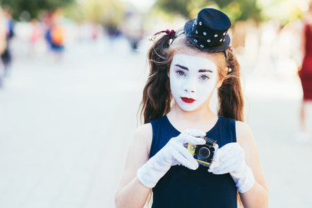 cute little girl mime shoots videos on the cameras Stock Photo