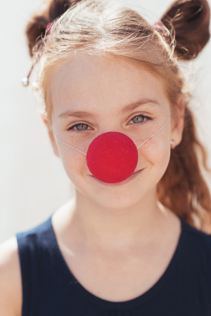 portrait of a little girl with a clown nose