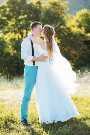 the bride and groom are photographed at sunset