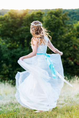 beautiful bride posing for the photographer on the nature Stock Photo