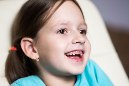 funny toothless girl laughing in his room