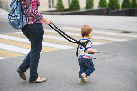 Mothers teach to walk on the road