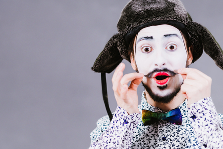 Mime poses and grimaces in the studio Stock Photo