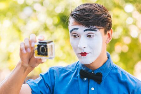 cute mime in shooting video on camera Foto de archivo