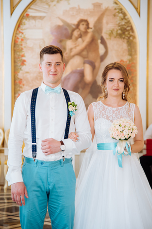the bride and groom photographed in registry office